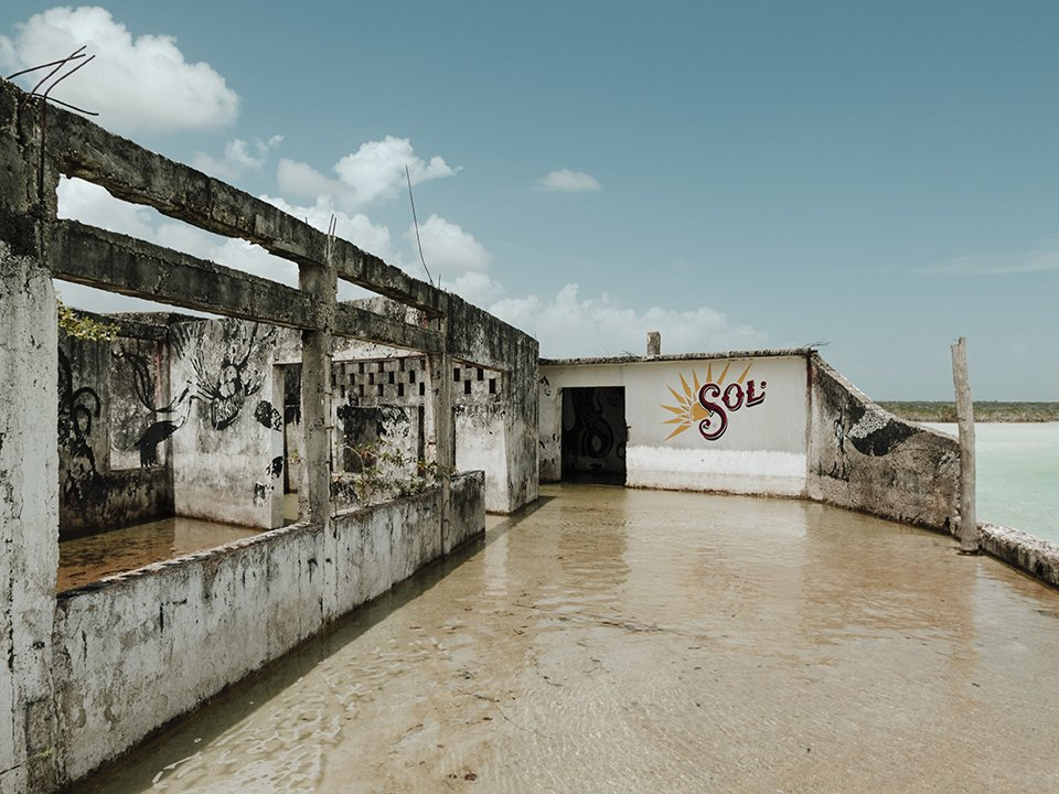elisabetta riccio - abandoned sol beer bar, whose ruins can be found sailing in the lake of 7 colors in the Bacalar lagoon, Quintana Roo