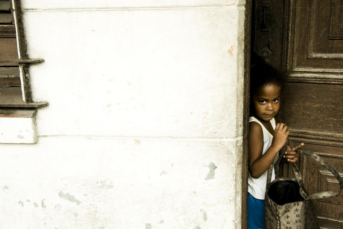 little girl as she leaves the door of her house