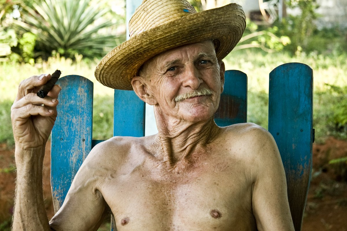portrait of an old man sitting on his rocking chair in Viniales, Havana
